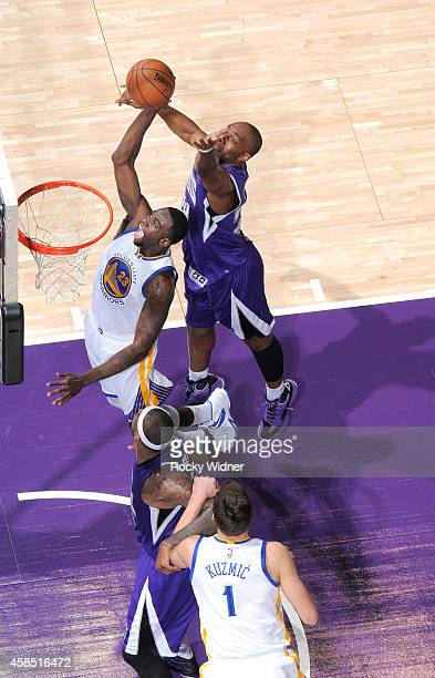 Draymond Green of the Golden State Warriors rebounds against Carl Landry of the Sacramento Kings on October 29 2014 at Sleep Train Arena in...