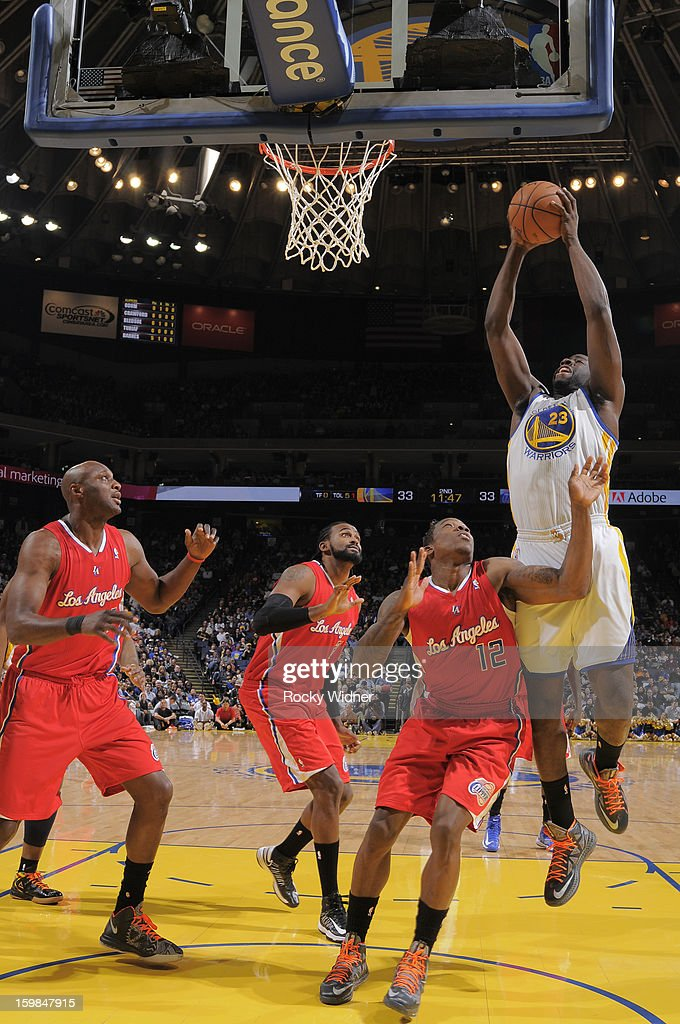Draymond Green #23 of the Golden State Warriors rebounds against Eric Bledsoe #12 of the Los Angeles Clippers on January 21, 2013 at Oracle Arena in Oakland, California.