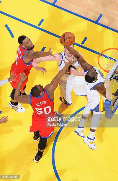 Draymond Green of the Golden State Warriors rebounds against Lavoy Allen of the Philadelphia 76ers on February 10 2014 at Oracle Arena in Oakland...