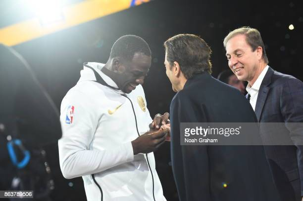 Draymond Green of the Golden State Warriors receives his rings during the NBA Championship ring ceremony before the game against the Houston Rockes...