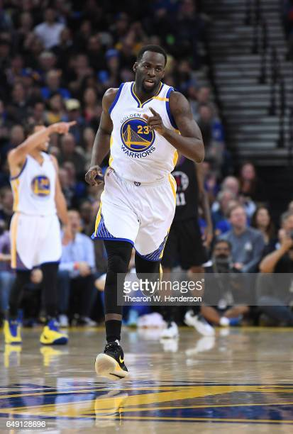 Draymond Green of the Golden State Warriors runs back up court after making a basket against the LA Clippers during an NBA basketball game at ORACLE...