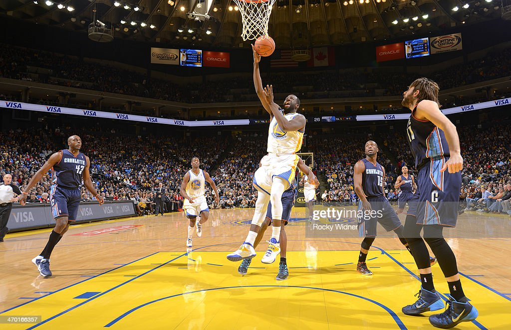 <a gi-track='captionPersonalityLinkClicked' href=/galleries/search?phrase=Draymond+Green&family=editorial&specificpeople=5628054 ng-click='$event.stopPropagation()'>Draymond Green</a> #23 of the Golden State Warriors shoots a layup against the Charlotte Bobcats on February 4, 2014 at Oracle Arena in Oakland, California.