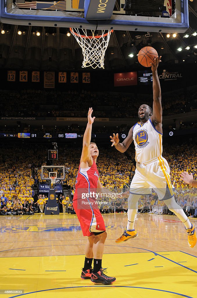 Draymond Green #23 of the Golden State Warriors shoots a layup against Blake Griffin #32 of the Los Angeles Clippers in Game Six of the Western Conference Quarterfinals during the 2014 NBA Playoffs at Oracle Arena on May 1, 2014 in Oakland, California.