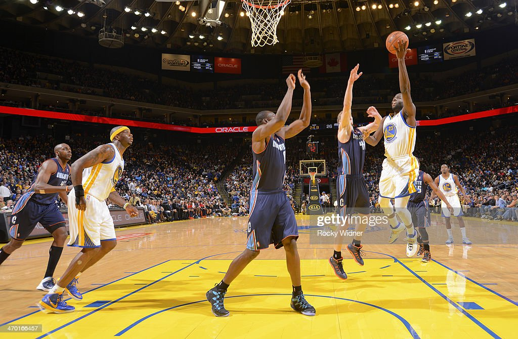 <a gi-track='captionPersonalityLinkClicked' href=/galleries/search?phrase=Draymond+Green&family=editorial&specificpeople=5628054 ng-click='$event.stopPropagation()'>Draymond Green</a> #23 of the Golden State Warriors shoots against Jeff Taylor #44 of the Charlotte Bobcats on February 4, 2014 at Oracle Arena in Oakland, California.