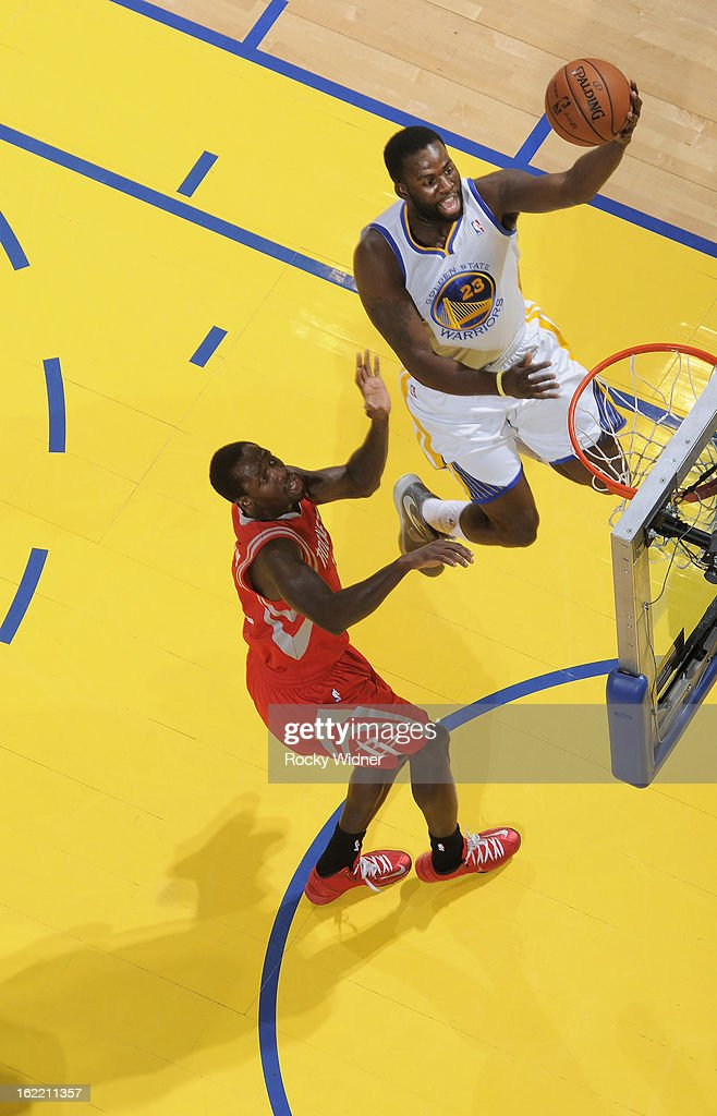 <a gi-track='captionPersonalityLinkClicked' href=/galleries/search?phrase=Draymond+Green&family=editorial&specificpeople=5628054 ng-click='$event.stopPropagation()'>Draymond Green</a> #23 of the Golden State Warriors shoots against Patrick Beverley #12 of the Houston Rockets on February 12, 2013 at Oracle Arena in Oakland, California.