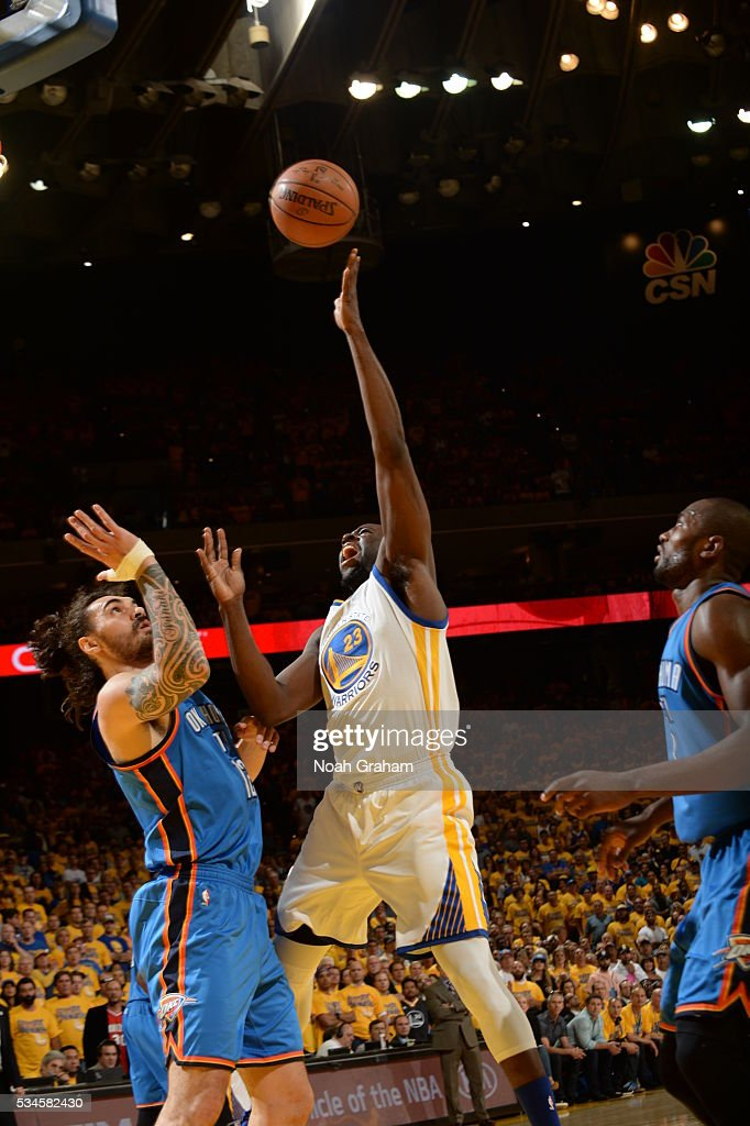 <a gi-track='captionPersonalityLinkClicked' href=/galleries/search?phrase=Draymond+Green&family=editorial&specificpeople=5628054 ng-click='$event.stopPropagation()'>Draymond Green</a> #23 of the Golden State Warriors shoots against <a gi-track='captionPersonalityLinkClicked' href=/galleries/search?phrase=Steven+Adams+-+Basketball+Player&family=editorial&specificpeople=10585110 ng-click='$event.stopPropagation()'>Steven Adams</a> #12 of the Oklahoma City Thunder during Game Five of the Western Conference Finals during the 2016 NBA Playoffs on May 26, 2016 at ORACLE Arena in Oakland, California.