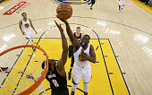 Draymond Green of the Golden State Warriors shoots over AlFarouq Aminu of the Portland Trail Blazers during Game Two of the Western Conference...