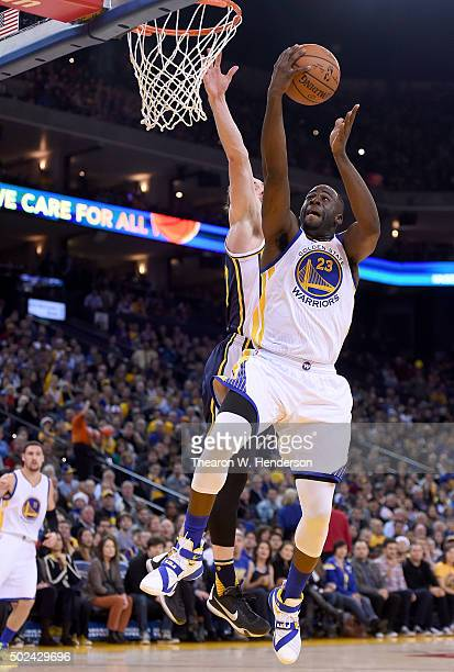 Draymond Green of the Golden State Warriors shoots over Gordon Hayward of the Utah Jazz during their NBA basketball game at ORACLE Arena on December...