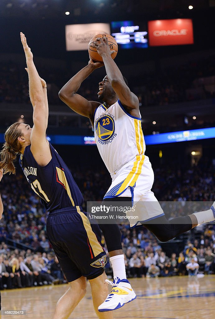 Draymond Green #23 of the Golden State Warriors shoots over Lou Amundson #17 of the New Orleans Pelicans at ORACLE Arena on December 17, 2013 in Oakland, California.
