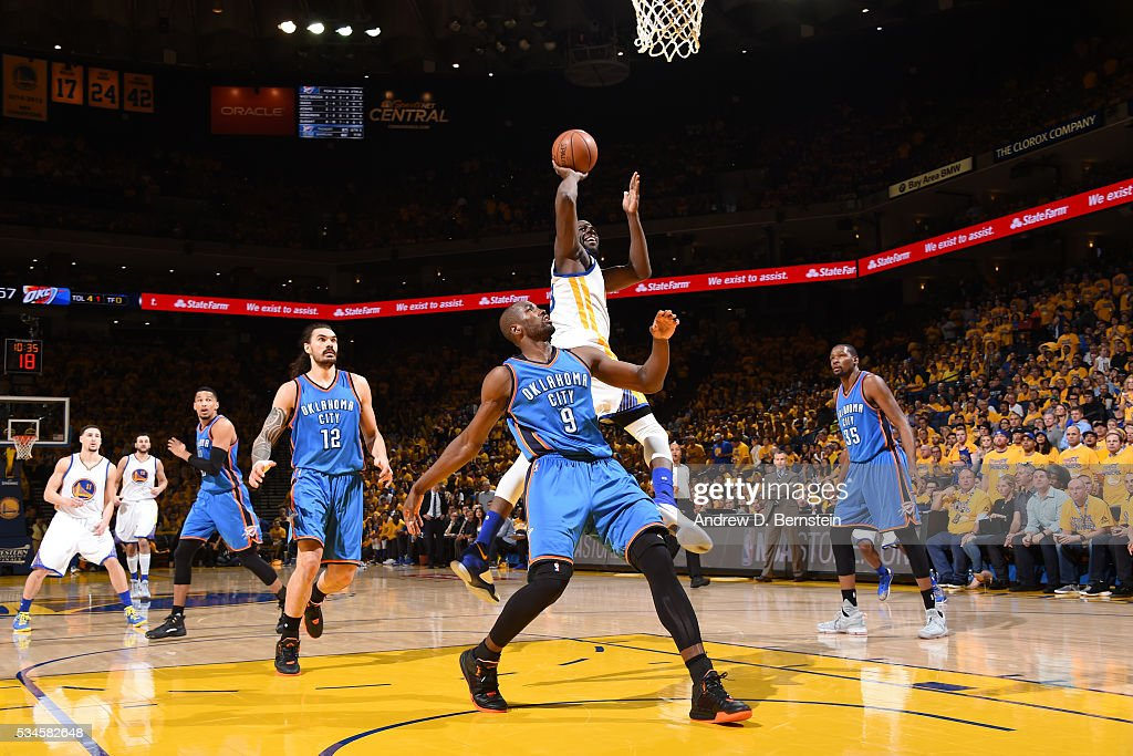 <a gi-track='captionPersonalityLinkClicked' href=/galleries/search?phrase=Draymond+Green&family=editorial&specificpeople=5628054 ng-click='$event.stopPropagation()'>Draymond Green</a> #23 of the Golden State Warriors shoots the ball against the Oklahoma City Thunder in Game Five of the Western Conference Finals during the 2016 NBA Playoffs on May 26, 2016 at ORACLE Arena in Oakland, California.