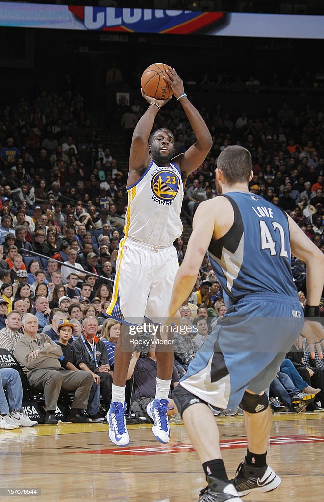 <a gi-track='captionPersonalityLinkClicked' href=/galleries/search?phrase=Draymond+Green&family=editorial&specificpeople=5628054 ng-click='$event.stopPropagation()'>Draymond Green</a> #23 of the Golden State Warriors shoots the ball over <a gi-track='captionPersonalityLinkClicked' href=/galleries/search?phrase=Kevin+Love&family=editorial&specificpeople=4212726 ng-click='$event.stopPropagation()'>Kevin Love</a> #42 of the Minnesota Timberwolves on November 24, 2012 at Oracle Arena in Oakland, California.