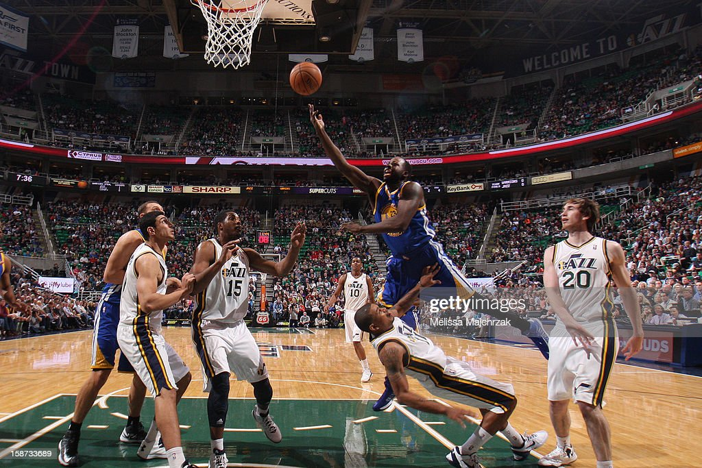 <a gi-track='captionPersonalityLinkClicked' href=/galleries/search?phrase=Draymond+Green&family=editorial&specificpeople=5628054 ng-click='$event.stopPropagation()'>Draymond Green</a> #23 of the Golden State Warriors shoots the layup against <a gi-track='captionPersonalityLinkClicked' href=/galleries/search?phrase=Earl+Watson&family=editorial&specificpeople=201841 ng-click='$event.stopPropagation()'>Earl Watson</a> #11 of the Utah Jazz at Energy Solutions Arena on December 26, 2012 in Salt Lake City, Utah.