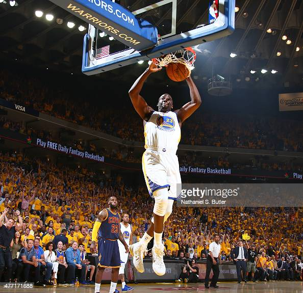 Draymond Green of the Golden State Warriors slam dunks during Game Five of the 2015 NBA Finals on June 14 2015 at Oracle Arena in Oakland California...