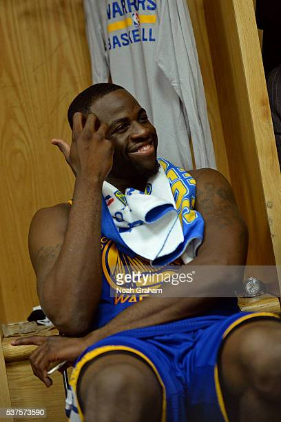 Draymond Green of the Golden State Warriors smiles and sits at his locker before Game Five of the Western Conference Finals against the Oklahoma City...