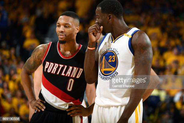 Draymond Green of the Golden State Warriors talks with Damian Lillard of the Portland Trail Blazers during the game during the Western Conference...