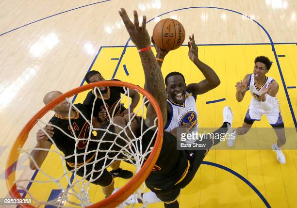 Draymond Green of the Golden State Warriors throws up a shot against JR Smith of the Cleveland Cavaliers in Game 5 of the 2017 NBA Finals at ORACLE...