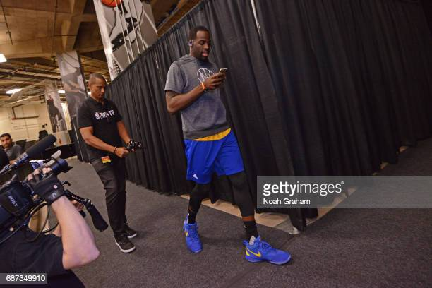 Draymond Green of the Golden State Warriors walks to the court before Game Four of the Western Conference Finals against the San Antonio Spurs during...