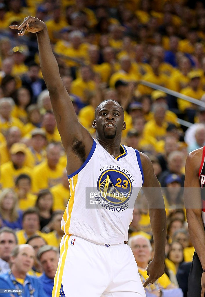 Draymond Green #23 of the Golden State Warriors watches a three-point basket go in against the Portland Trail Blazers during Game One of the Western Conference Semifinals for the 2016 NBA Playoffs at ORACLE Arena on May 01, 2016 in Oakland, California.