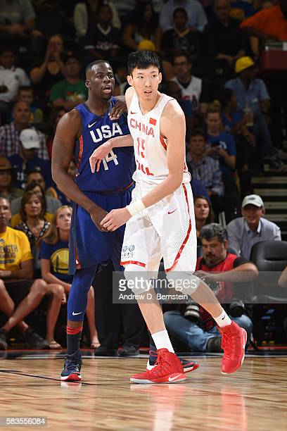 Draymond Green of the USA Basketball Men's National Team defends against Zhou Qi of China on July 26 2016 at ORACLE Arena in Oakland California NOTE...