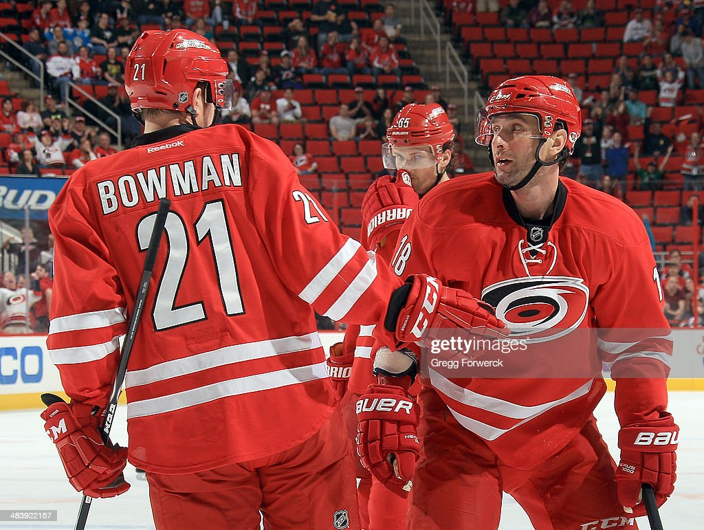 Drayson Bowman #21 of the Carolina Hurricanes congratulates <a gi-track='captionPersonalityLinkClicked' href=/galleries/search?phrase=Radek+Dvorak&family=editorial&specificpeople=202867 ng-click='$event.stopPropagation()'>Radek Dvorak</a> #18 on his third-period goal against the Washington Capitals during their NHL game at PNC Arena on April 10, 2014 in Raleigh, North Carolina.
