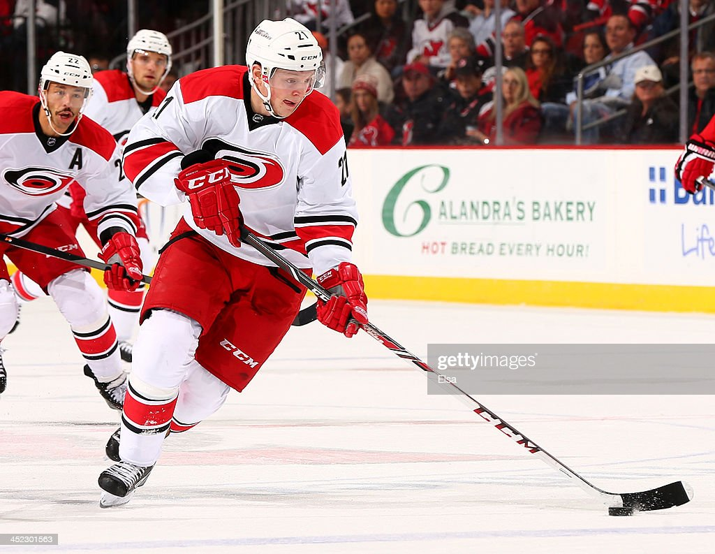 <a gi-track='captionPersonalityLinkClicked' href=/galleries/search?phrase=Drayson+Bowman&family=editorial&specificpeople=4111563 ng-click='$event.stopPropagation()'>Drayson Bowman</a> #21 of the Carolina Hurricanes takes the puck in the first period against the New Jersey Devils at Prudential Center on November 27, 2013 in Newark, New Jersey.