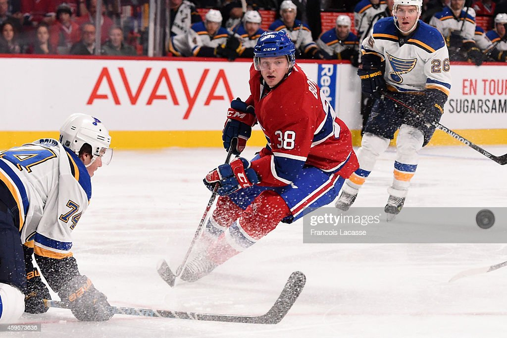 <a gi-track='captionPersonalityLinkClicked' href=/galleries/search?phrase=Drayson+Bowman&family=editorial&specificpeople=4111563 ng-click='$event.stopPropagation()'>Drayson Bowman</a> #38 of the Montreal Canadiens passes the puck against <a gi-track='captionPersonalityLinkClicked' href=/galleries/search?phrase=T.J.+Oshie&family=editorial&specificpeople=700383 ng-click='$event.stopPropagation()'>T.J. Oshie</a> #74 of the St Louis Blues in the NHL game at the Bell Centre on November 20, 2014 in Montreal, Quebec, Canada.