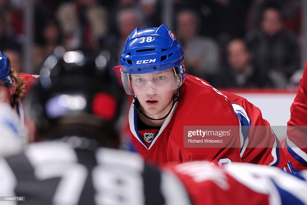 <a gi-track='captionPersonalityLinkClicked' href=/galleries/search?phrase=Drayson+Bowman&family=editorial&specificpeople=4111563 ng-click='$event.stopPropagation()'>Drayson Bowman</a> #38 of the Montreal Canadiens waits for a face-off during the NHL game against the Winnipeg Jets at the Bell Centre on November 11, 2014 in Montreal, Quebec, Canada. The Canadiens defeated the Jets 3-0.