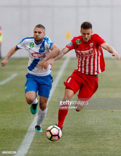 Drazen Okuka of MTK Budapest competes for the ball with Mark Tamas of DVTK during the Hungarian OTP Bank Liga match between MTK Budapest and DVTK at...