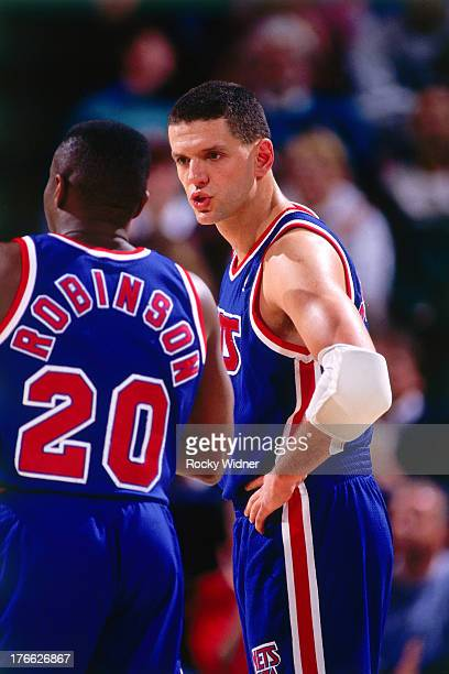 Drazen Petrovic and Rumeal Robinson of the New Jersey Nets talk against the Sacramento Kings on November 28 1992 at Arco Arena in Sacramento...