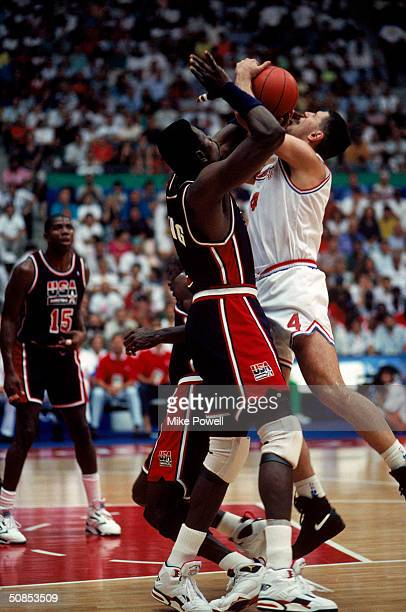 Drazen Petrovic of Croatia is blocked by Patrick Ewing of the United States during the 1992 Olympic game on July 27 1992 in Barcelona Spain The...