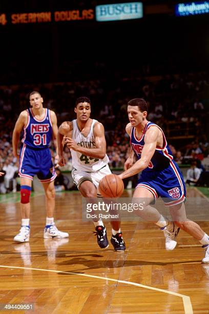 Drazen Petrovic of the New Jersey Nets drives against Rick Fox of the Boston Celtics during a game played in 1992 at the Boston Garden in Boston...