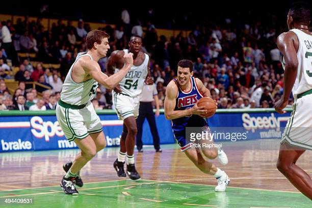 Drazen Petrovic of the New Jersey Nets drives against the Boston Celtics during a game played in 1992 at the Boston Garden in Boston Massachusetts...