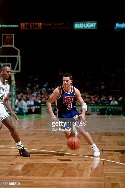 Drazen Petrovic of the New Jersey Nets handles the ball against the Boston Celtics during a game played at the Boston Garden in Boston Massachusetts...