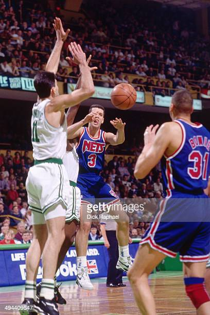 Drazen Petrovic of the New Jersey Nets passes the ball against the Boston Celtics during a game played in 1992 at the Boston Garden in Boston...