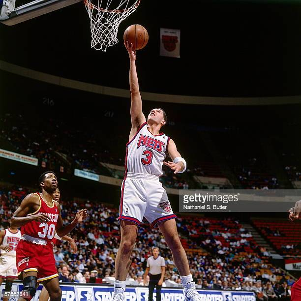 Drazen Petrovic of the New Jersey Nets shoots a layup against Kenny Smith of the Houston Rockets at the Brendan Byrne Arena on January 30 1993 in...