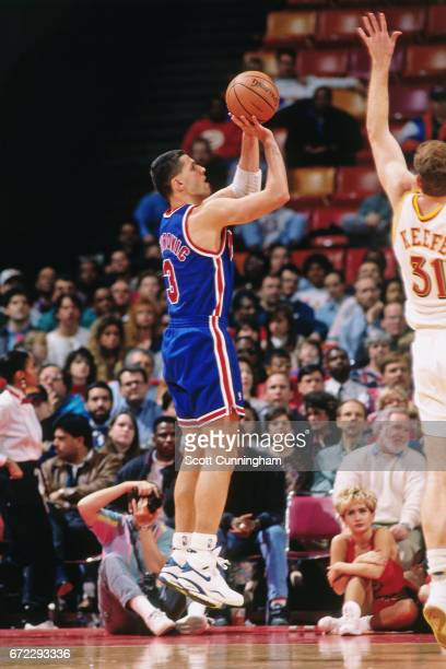 Drazen Petrovic of the New Jersey Nets shoots against the Atlanta Hawks during a game played circa 1990 at the Omni in Atlanta Georgia NOTE TO USER...
