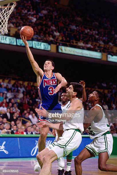 Drazen Petrovic of the New Jersey Nets shoots against the Boston Celtics during a game played in 1992 at the Boston Garden in Boston Massachusetts...