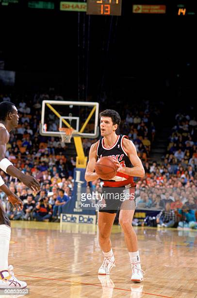 Drazen Petrovic of the Portland Trail Blazers passes the ball during the game against the Los Angeles Lakers during a 198990 season game at the Great...