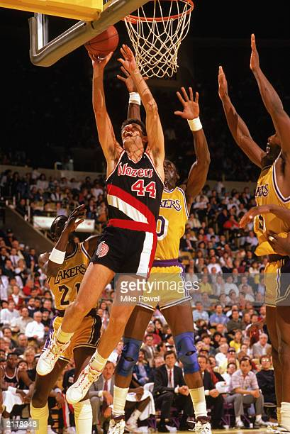 Drazen Petrovic of the Portland Trail Blazers shoots against the Los Angeles Lakers during the 19891990 NBA season game at the Great Western Forum in...
