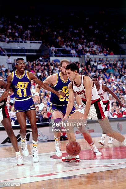 Drazen Petrovic of the Portland Trailblazers dribbles against Mark Eaton of the Utah Jazz circa 1990 at the Veterans Memorial Coliseum in Portland...