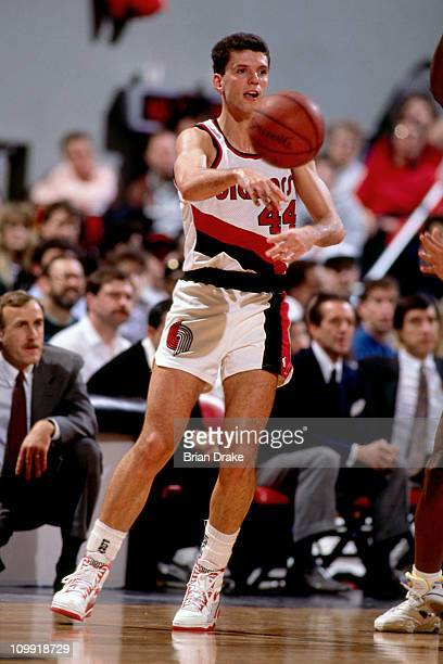 Drazen Petrovic of the Portland Trailblazers passes circa 1990 at the Veterans Memorial Coliseum in Portland Oregon NOTE TO USER User expressly...