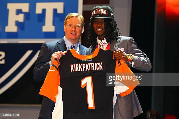 Dre Kirkpatrick of Alabama holds up a jersey as he stands on stage with NFL Commissioner Roger Goodell after he was selected overall by the...