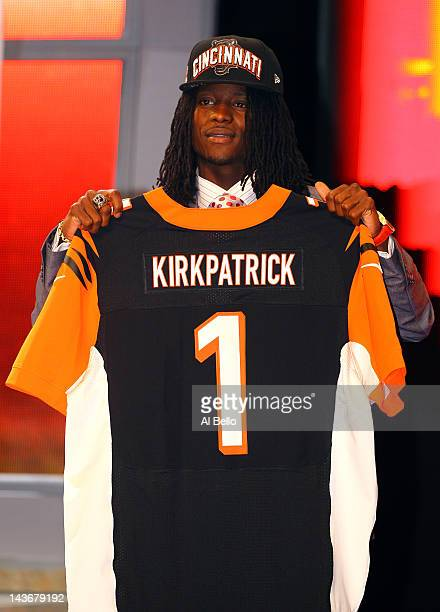 Dre Kirkpatrick of Alabama holds up a jersey as he stands on stage after he was selected overall by the Cincinnati Bengals in the first round of...