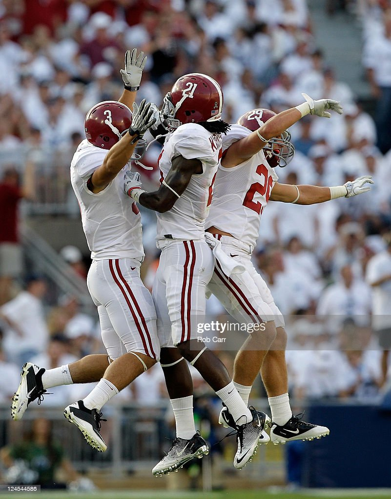 Dre Kirkpatrick #21 of the Alabama Crimson Tide celebrates with teammates Vinnie Sunseri #3 and Will Lowery #29 after causing a fumble against the Penn State Nittany Lions during the second half at Beaver Stadium on September 10, 2011 in State College, Pennsylvania.