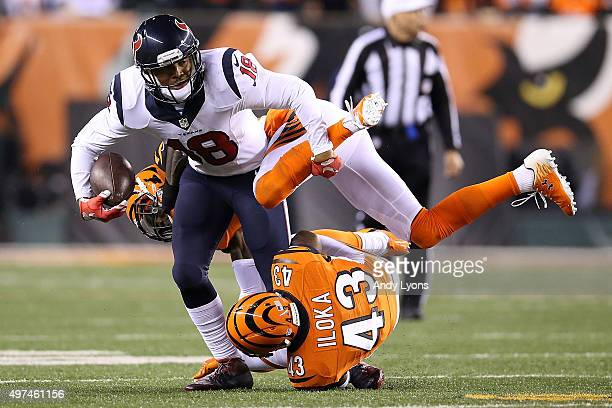 Dre Kirkpatrick of the Cincinnati Bengals and George Iloka of the Cincinnati Bengals combine to tackle Cecil Shorts III of the Houston Texans during...