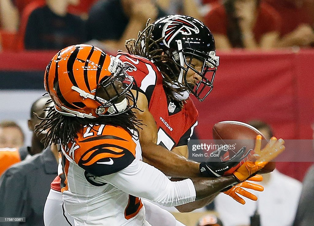 Dre Kirkpatrick #27 of the Cincinnati Bengals breaks up a pass intended for Kevin Cone #15 of the Atlanta Falcons at Georgia Dome on August 8, 2013 in Atlanta, Georgia.