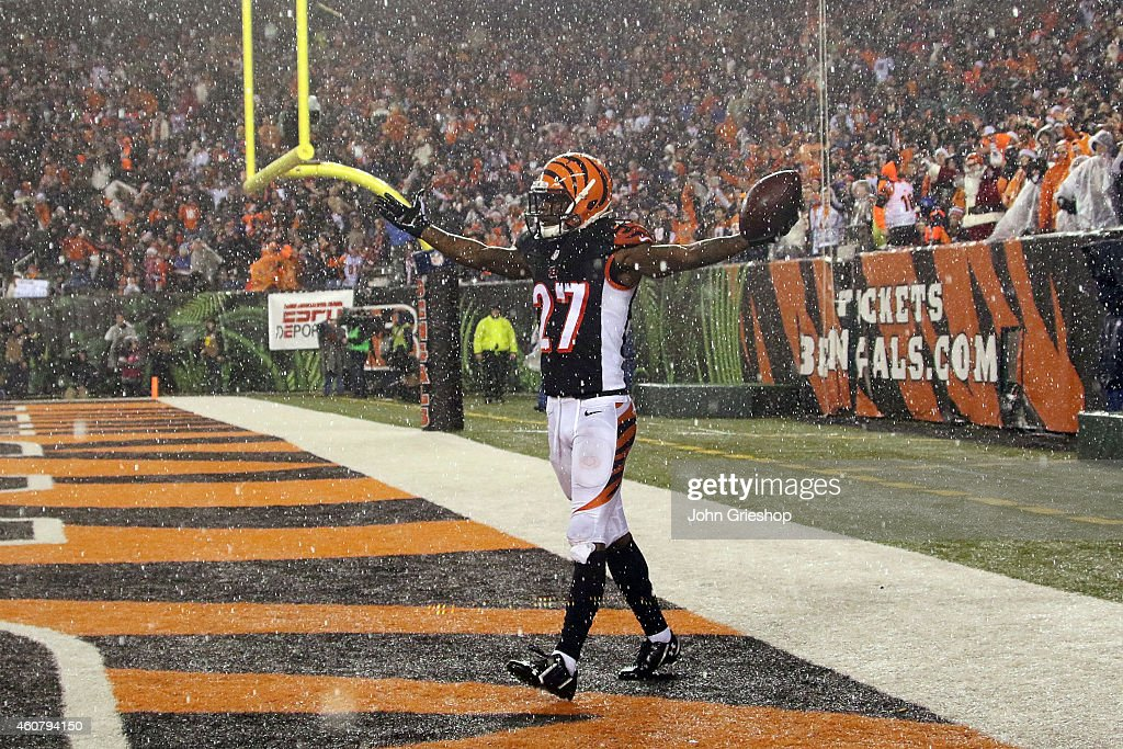 Dre Kirkpatrick #27 of the Cincinnati Bengals celebrates after making an interception late in the fourth quarter of the game against the Denver Broncos at Paul Brown Stadium on December 22, 2014 in Cincinnati, Ohio. Cincinnati defeated Denver 37-28.