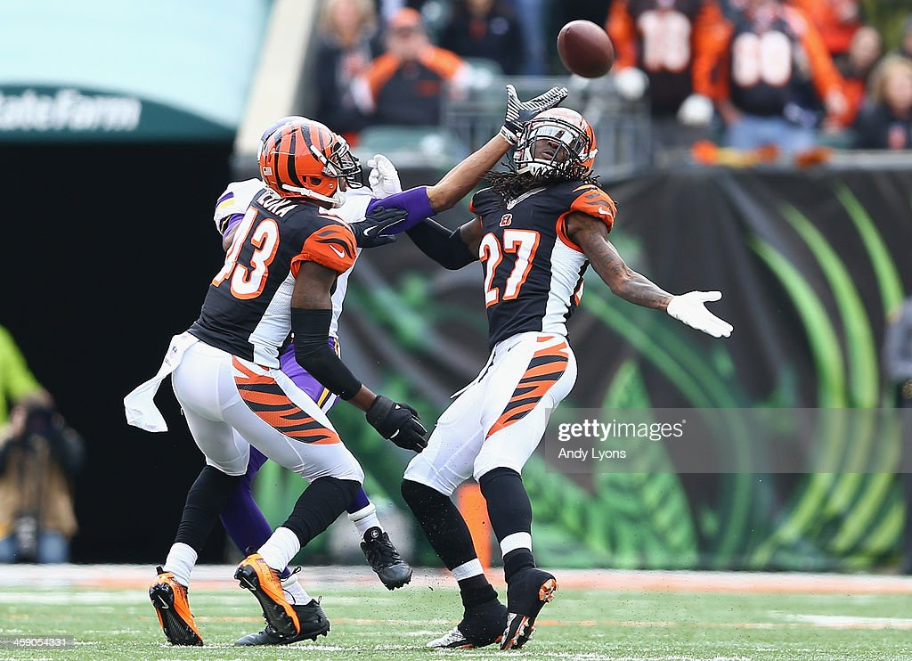 <a gi-track='captionPersonalityLinkClicked' href=/galleries/search?phrase=Dre+Kirkpatrick&family=editorial&specificpeople=6699002 ng-click='$event.stopPropagation()'>Dre Kirkpatrick</a> #27 of the Cincinnati Bengals reaches up to intercept a pass during the NFL game against the Minnesota Vikings at Paul Brown Stadium on December 22, 2013 in Cincinnati, Ohio.