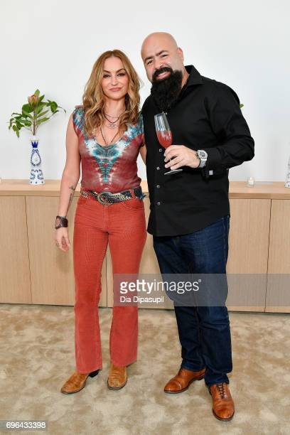 Drea de Matteo and Clase Azul founder/owner Arturo Lomeli attend the 20th Anniversary Celebration of Clase Azul Tequila at Public hotel on June 15...