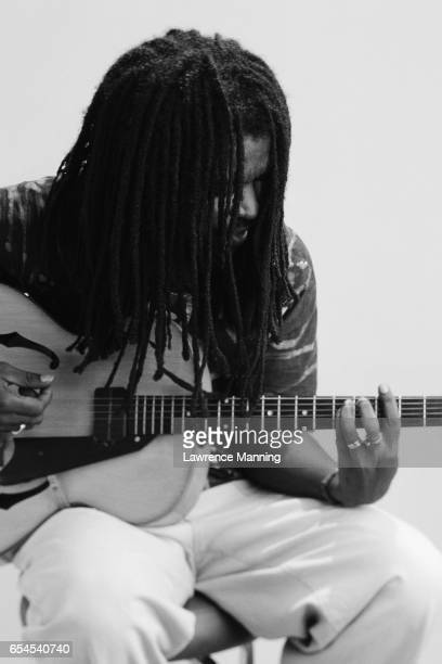 Dreadlocked Man Playing Guitar